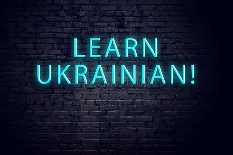 Brick wall and neon sign with inscription. Concept of learning ukrainian.  vector illustration