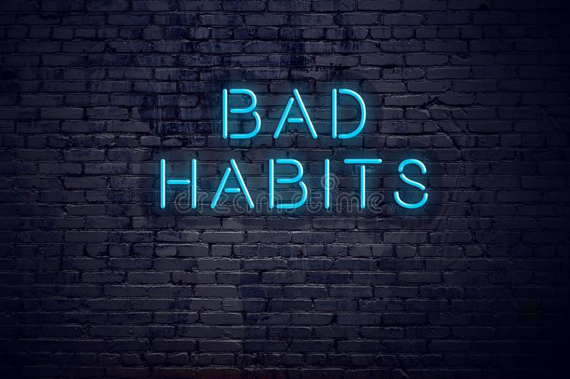 Brick wall and neon sign with text bad habits stock illustration