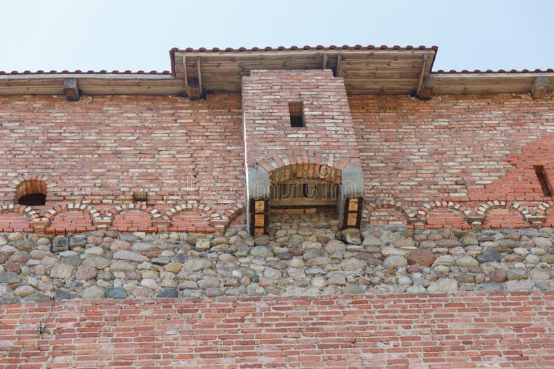 Brick wall of an old castle with toilet rooms. On the facade stock images