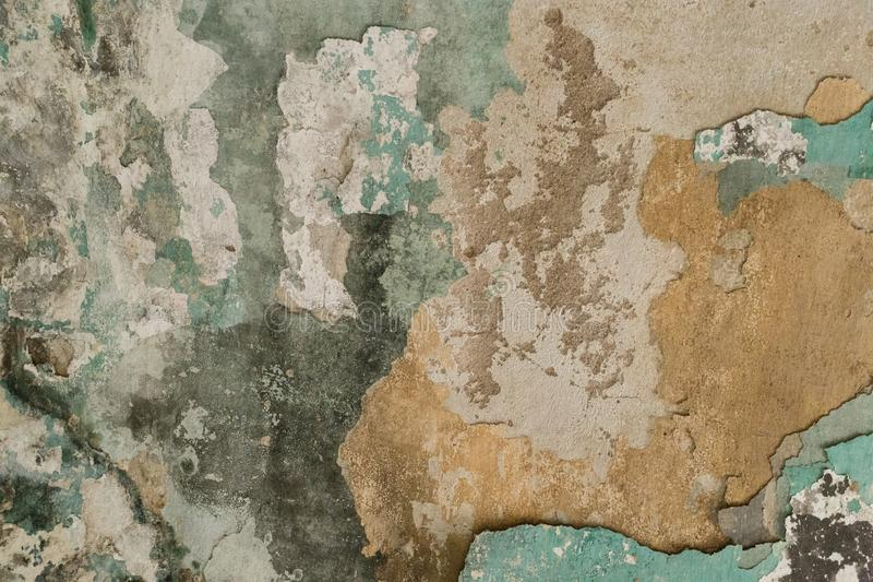 Brick wall. Old flaky white paint peeling off a grungy cracked wall. Cracks, scrapes, peeling old paint and plaster on background royalty free stock photos