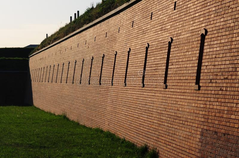 Fortification in Zamosc, Lublin Voivodeship, Poland. Brick wall of old military system of fortification in Zamosc city,southeastern Poland. city fortressexample royalty free stock photo