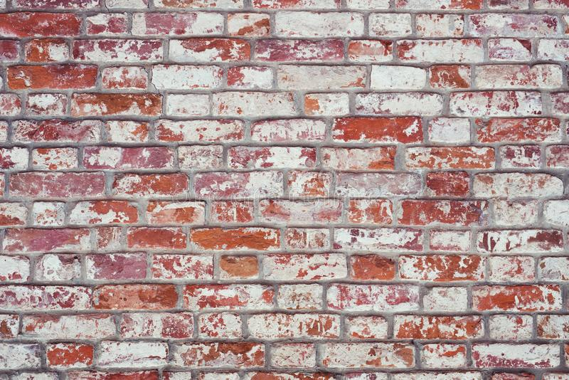 Brick wall, old texture of red stone blocks. Background. stock image