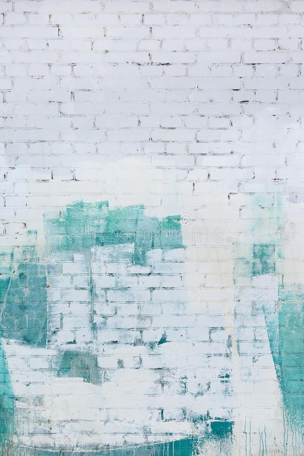 Brick wall painted abstractly with white and green paint. Background, texture. royalty free stock photos
