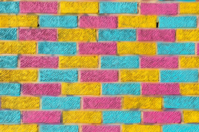 Brick Wall Painted In Bright Yellow, Blue And Pink Colors Stock ...