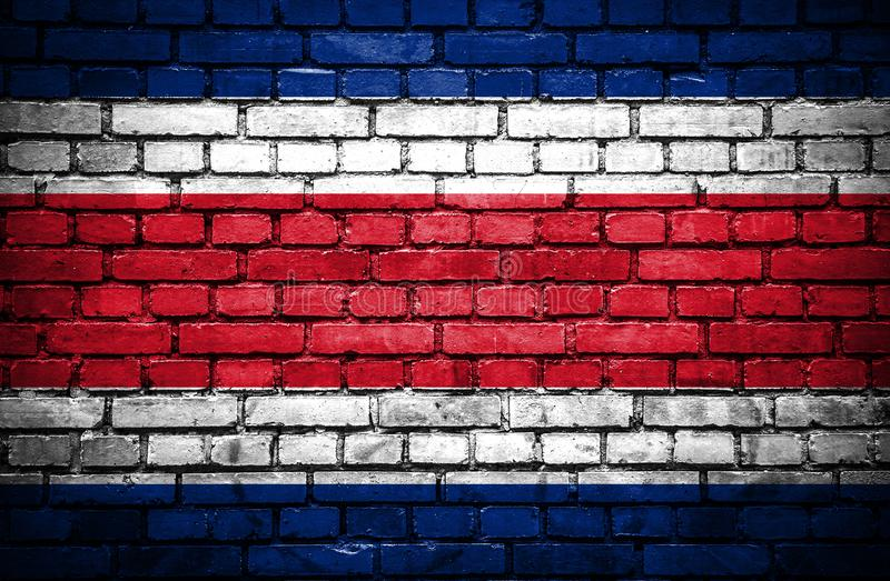 Brick wall with painted flag of Costa Rica stock illustration