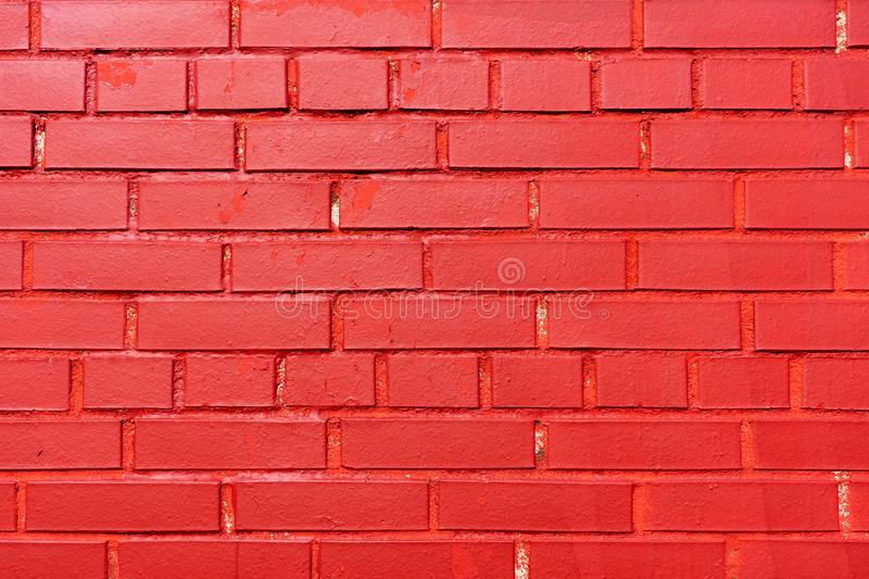Brick wall painted red. Texture. Background. stock photography