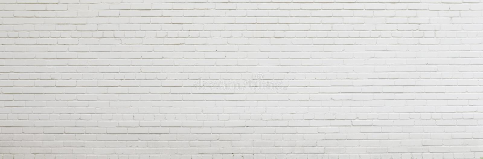 Brick wall painted with white paint. stock photography