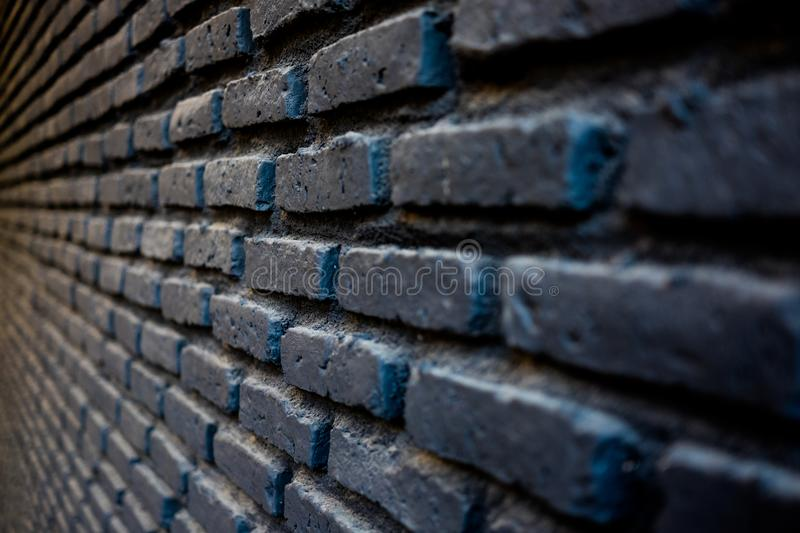 Brick wall pattern in black color. stock photography