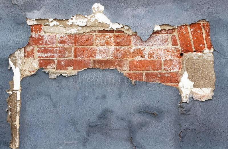 Brick wall with peeling paint and plaster in need of repair stock photos
