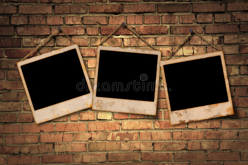 Brick Wall And Photos Royalty Free Stock Images