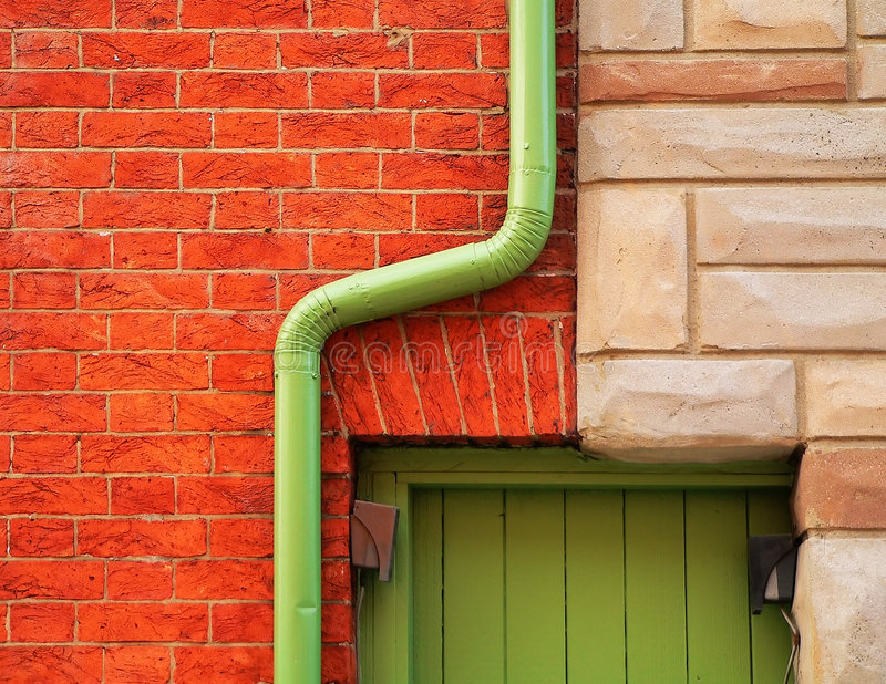 Brick Wall and Rain Gutter stock image