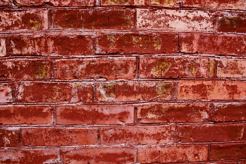 Brick wall, red, brown, yellow colors, old wall. Brick wall, red brown yellow colors, old wall, background for design, burgundy brick plane close-up, geometry stock image