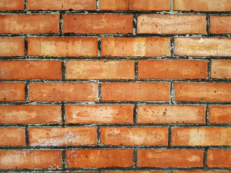 The brick wall of red color, wide panorama of masonry. Background  of old vintage brick wall royalty free stock photography