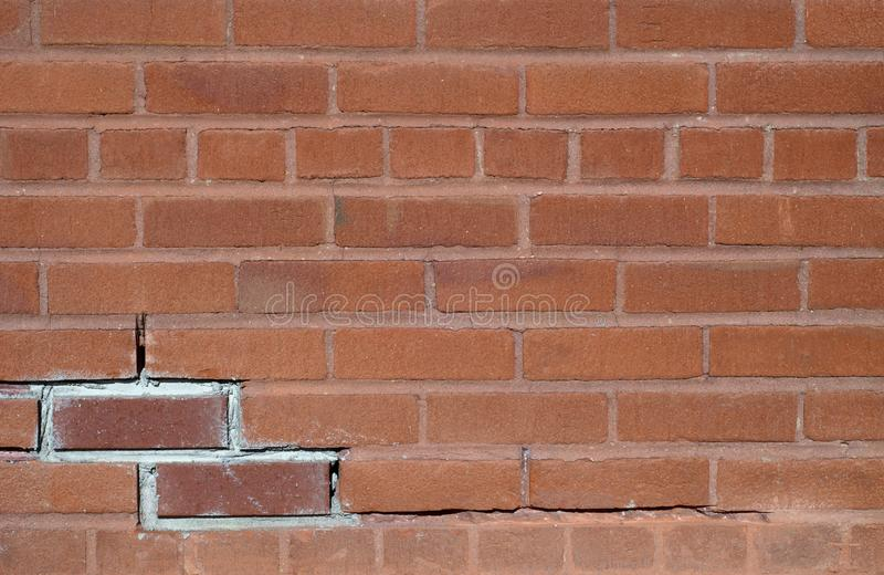 Brick wall red cracked old background pattern stock images