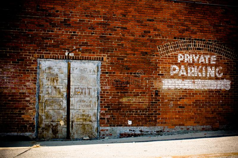 Brick Wall Rustic Old Metal Doors Private Parking royalty free stock photography