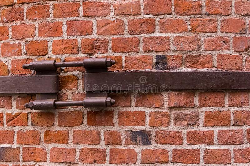 Brick wall small square stone metal plate screed protection against danger destruction industrial background stock images