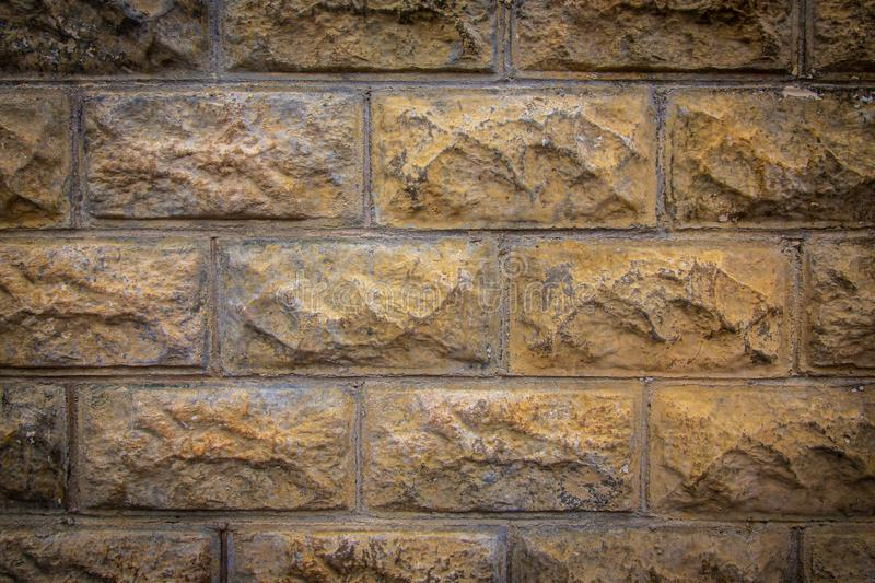 Brick wall texture with a light vignette stock images