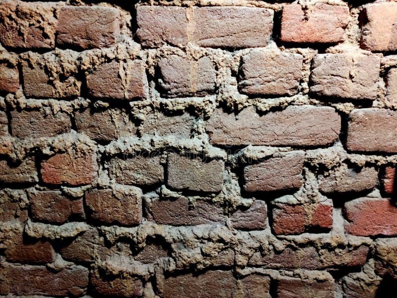 Brick wall textured backgroud wallpaper. Mud, mudwall, color royalty free stock image