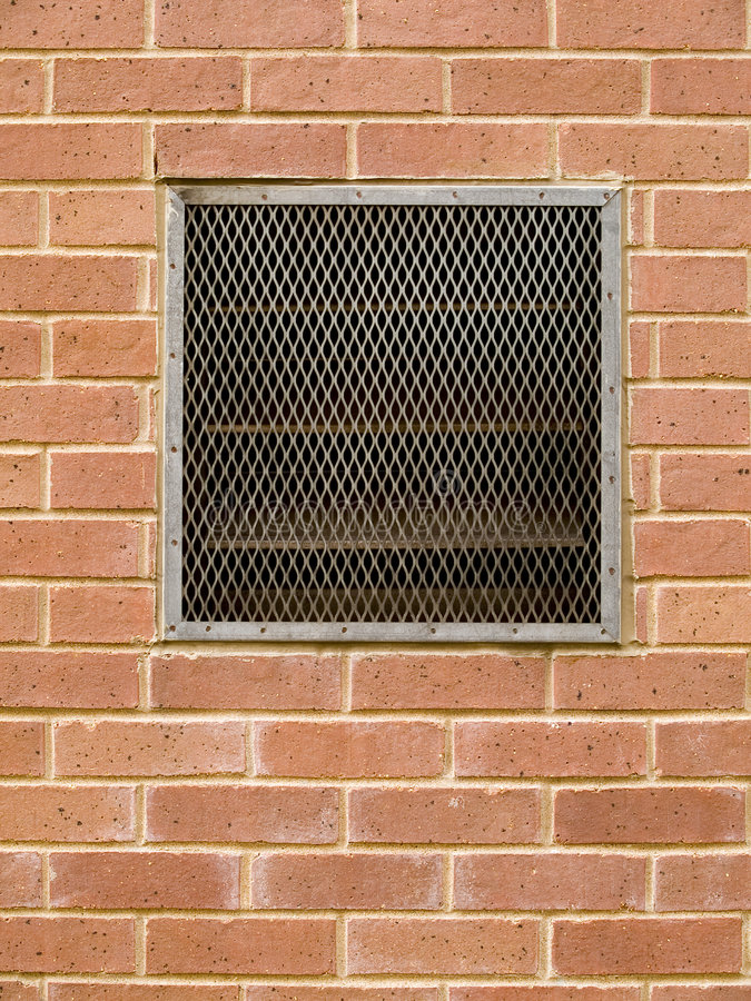 Brick wall with vent stock image