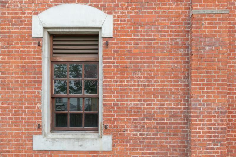 Brick wall with vintage window. Background and texture stock photos