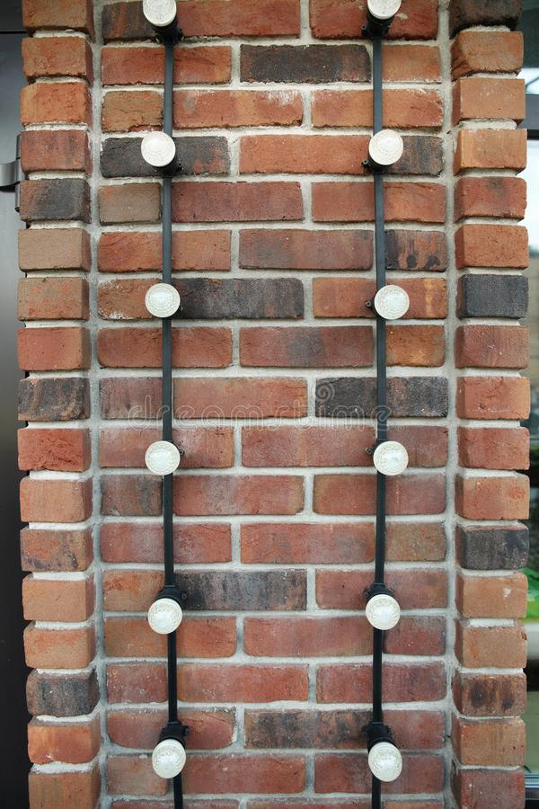 Brick wall, which is attached to the wiring with led lights for the decoration. Of the building stock images