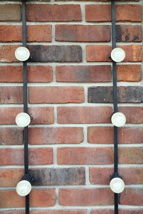 Brick wall on which the wiring is attached with led lighting. Brick wall on which the transaction is attached with the light bulbs led lighting royalty free stock photography