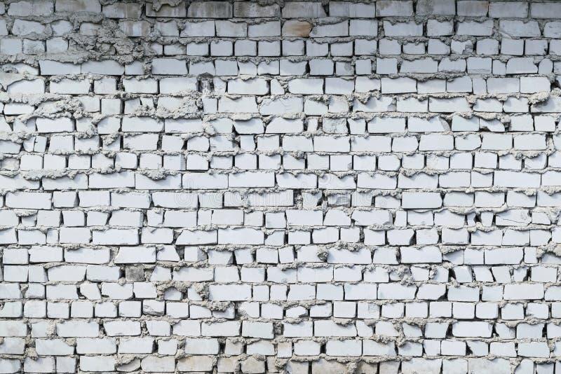 Brick wall white brick. Laying sloppy. Bricks of different sizes chipped. royalty free stock photo