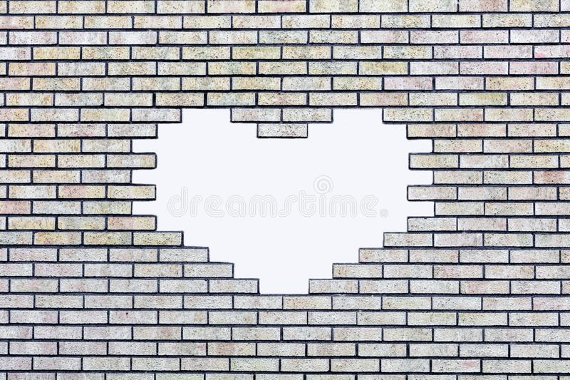 Brick wall with a white, heart-shaped hole for text. Brick wall with a white, heart-shaped hole for custom text royalty free stock images