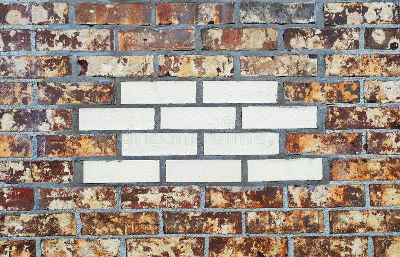Brown brick wall white insert facade pattern texture backdrop stock photo