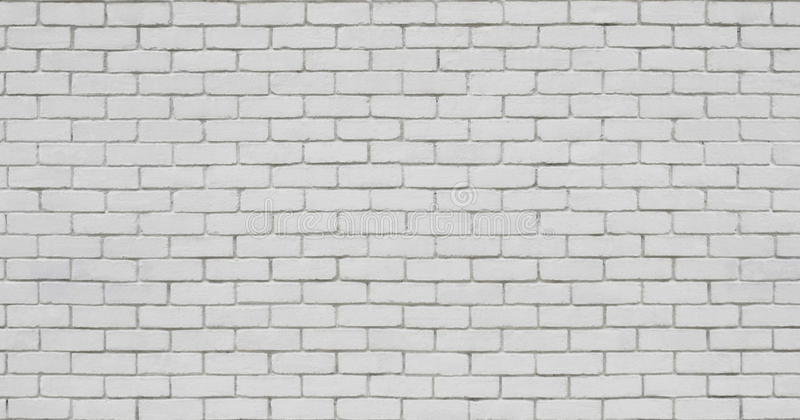 Brick wall in white stock photography