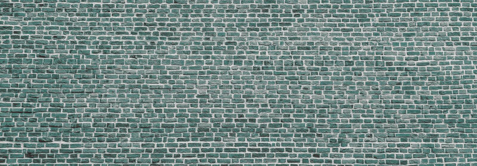 Brick wall, wide panorama of mint color masonry. Wall with small Bricks. Modern wallpaper design for web or graphic art projects. Abstract template or mock up stock images