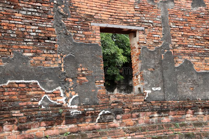 The brick wall and window of church in the ruins of ancient remains at Wat Worachet temple. stock images