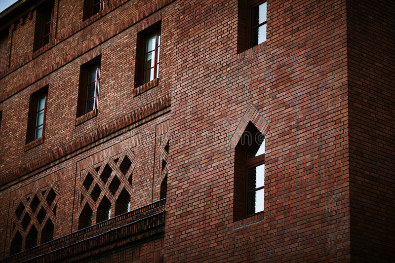 Brick wall and windows. Red brick wall and windows of church against Angle stock images