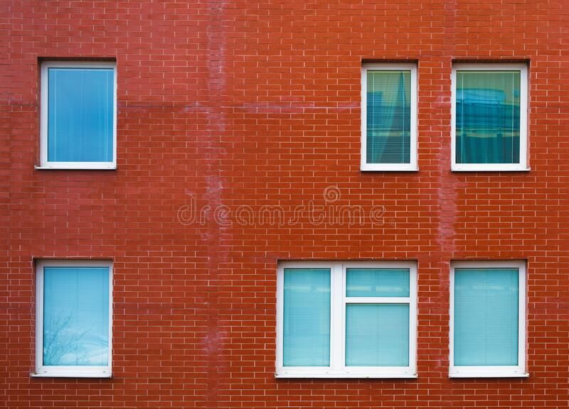 Brick wall with windows royalty free stock photography