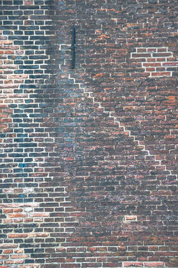 Free Brick Wall With Many Layers Of Old Paint And Different Patterns Stock Images - 118329764