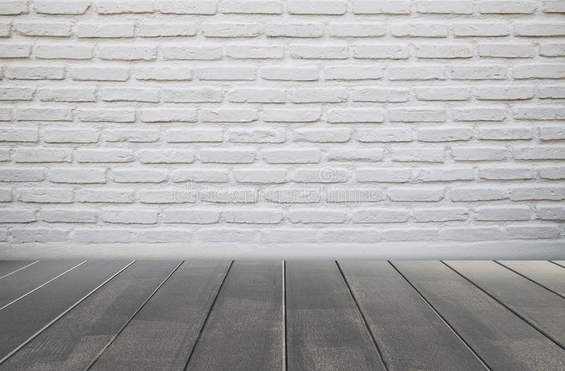Brick wall and wood floor stock image