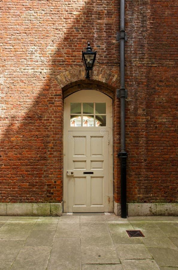 Brick wall with wooden door stock image