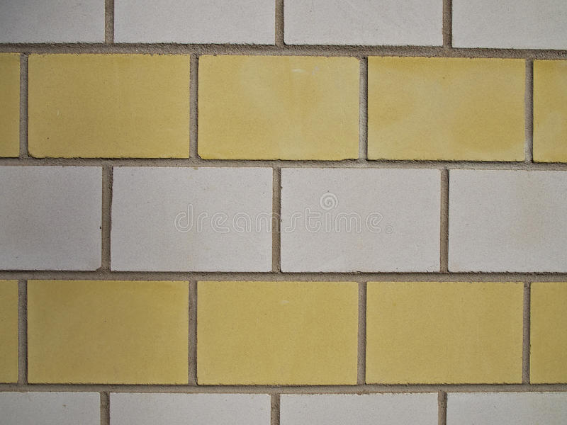 Brick Wall With Yellow And White Bricks stock photos