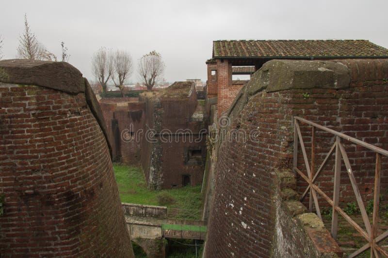 Brick walls and moat around Medici Fortress of Santa Barbara. Pistoia. Tuscany. Italy. stock photo