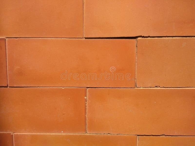 The brick walls are orange. Brick walls orange wallpaper background stock photo