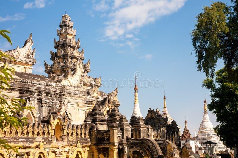 Maha Aung Mye Bon Zan monastery, Mandalay, Burma. The brick yellow Maha Aung Mye Bon Zan monastery on the Inwa royal site near Mandalay stock photo