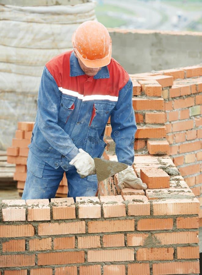 Bricklayer работника каменщика конструкции стоковые изображения