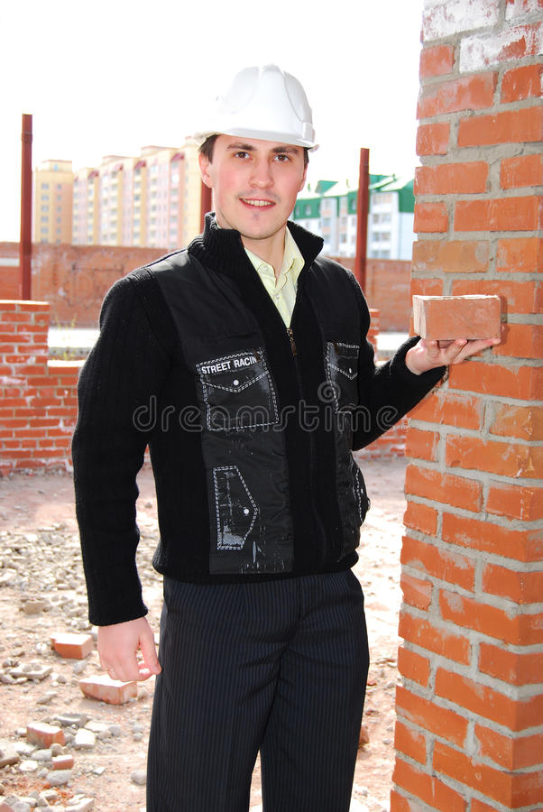 Bricklayer with brick. royalty free stock photo