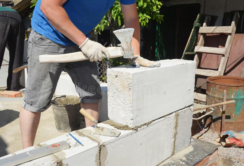 Bricklayer builder laying autoclaved aerated concrete blocks, aac for new house wall. Photo stock photo