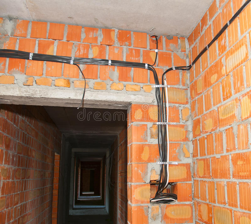 bricklayer building new house with brick walls interior rooms rh dreamstime com wiring a metal building electrical wiring a building
