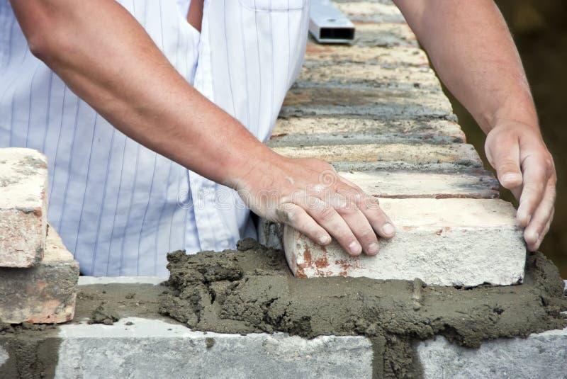 Bricklayer hands closeup stock image