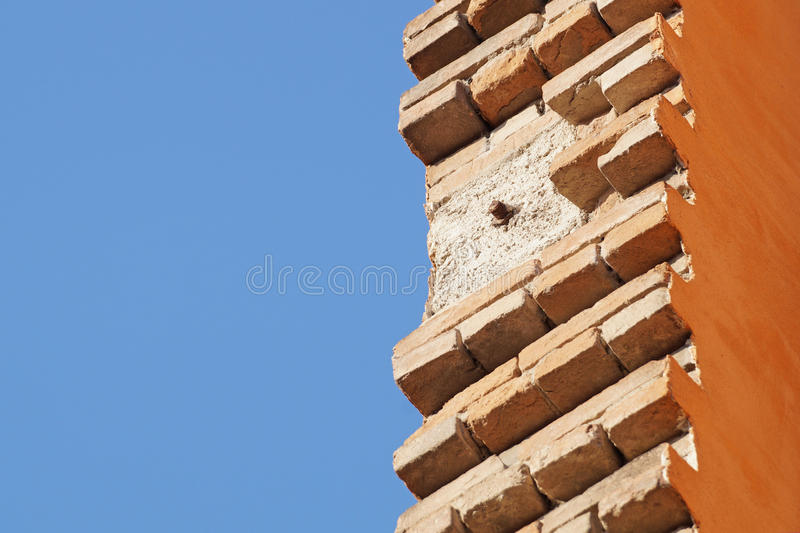 Bricklayer installing bricks on construction site stock images