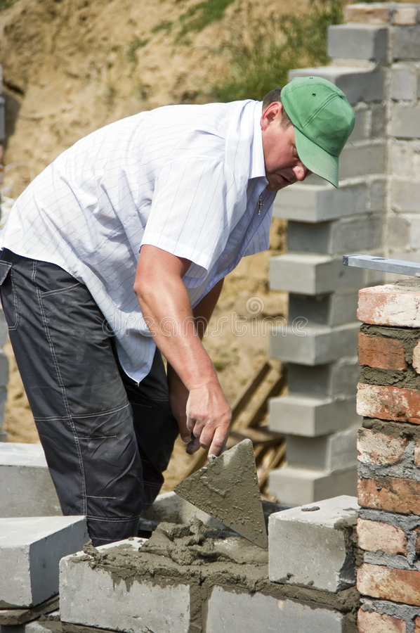 Download Bricklayer at work stock image. Image of skillful, distracted - 5465127