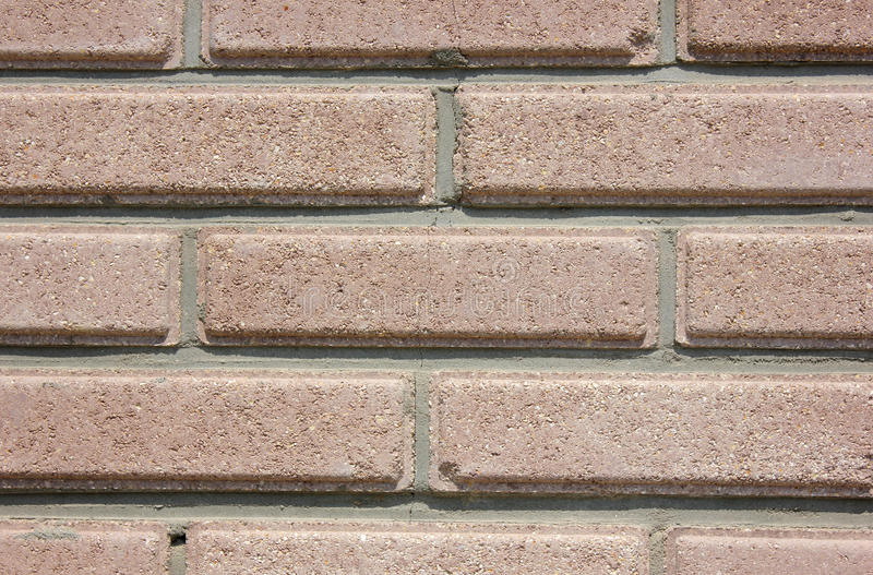Bricklaying. House wall element from a brown brick stock photos