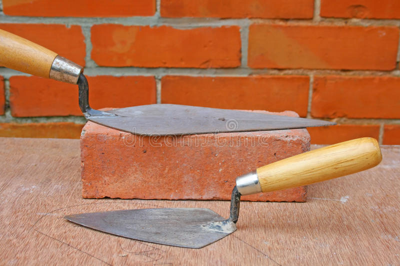 Download Bricklaying trowels stock photo. Image of construction - 12684190